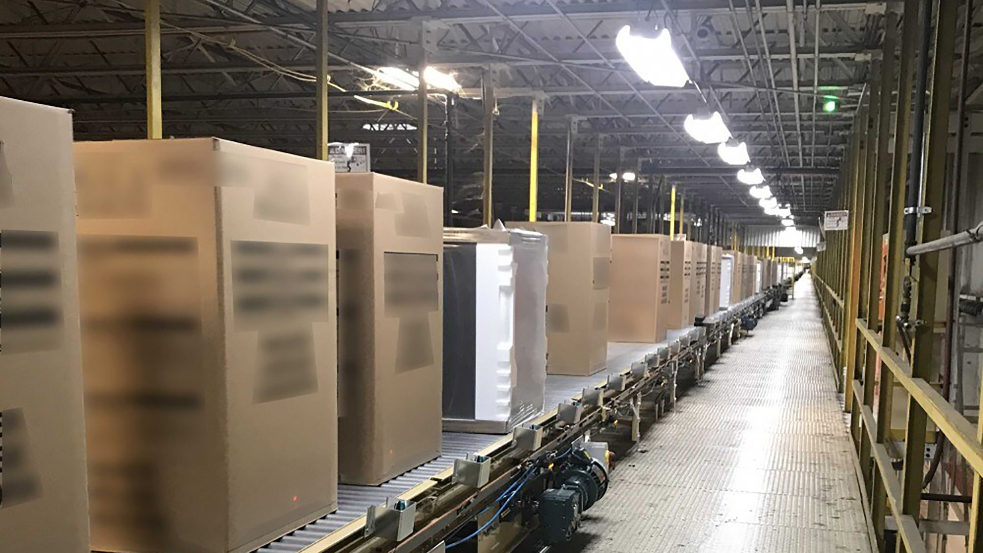 conveyor belt with boxes on it