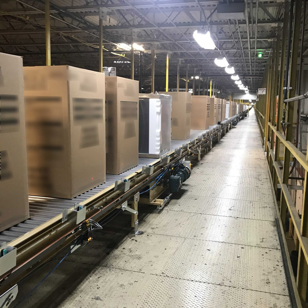 conveyor belt filled with boxes